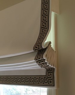 Cream roman blinds with trim